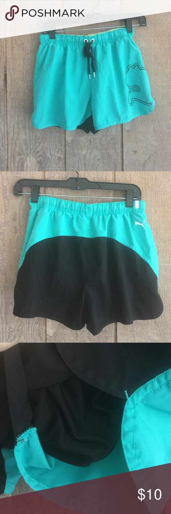 Puma shorts. XS Teal and black Puma shorts. XS. 2 snags in black fabric in back. Did not show up well in pics. Shorts also have a black inner panty as pictured. Puma Shorts