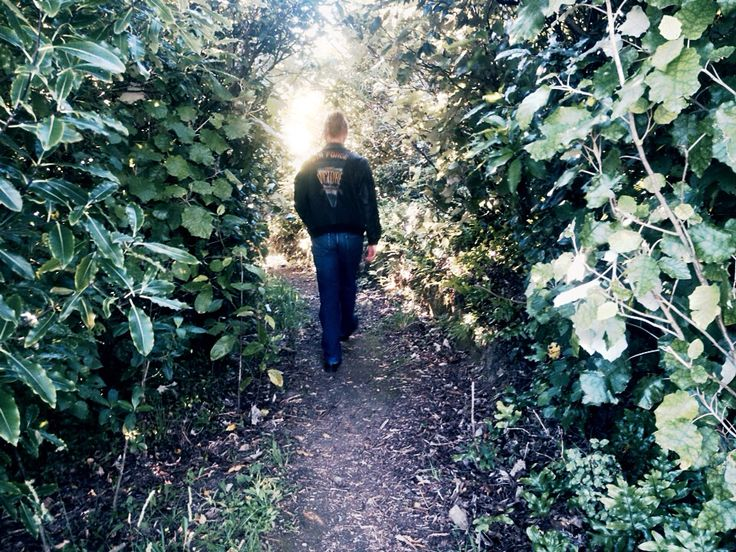Ethan walking down a path from one tree hill