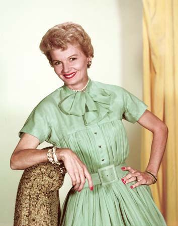 Barbara Billingsley as June Cleaver.  The show had its debut on CBS on October 4, 1957, I love this color pic of her!