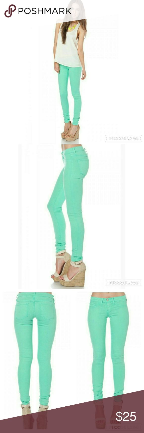 "Mint Colored Skinny Jeans Feature faux hip pockets, back pockets, and a single button closure. Runs small. -43% lyocell, 26% cotton, 17% rayon, 13% polyester, 1% spandex - 7"" rise - 31.5"" inseam - 10.5"" leg opening flying monkey Jeans Skinny"