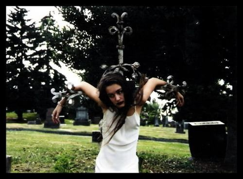 Long brown hair, brown eyes, short, mouthy and likes to roam cemeteries... Sounds like someone I know