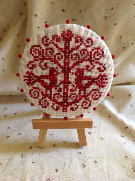 Hand stitched,cross stitched red bird pin keep.