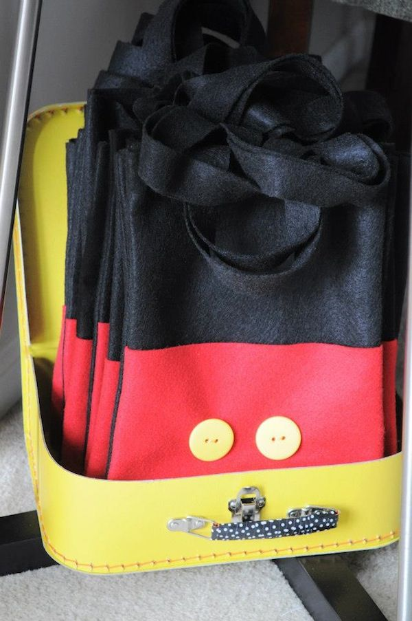 Mickey favor bags (felt and buttons) -- adorable! There are some other super cute ideas on this page (and some seriously over the top ones too!)