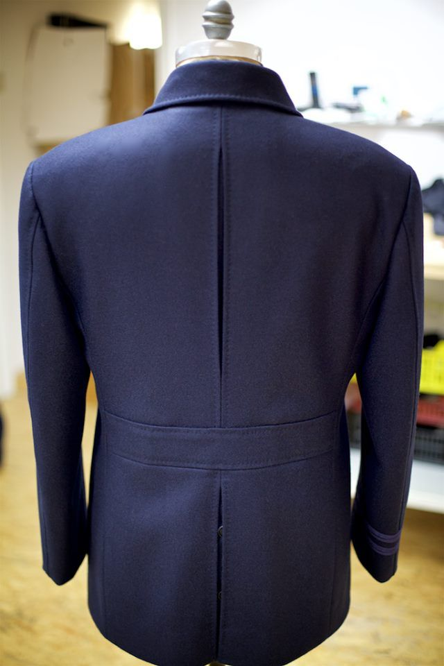 In this classic, double-breasted Naval Pea Coat, we have 'swelled' the edges and seams by prick-stitching with silk twist to accentuate the seam lines.
