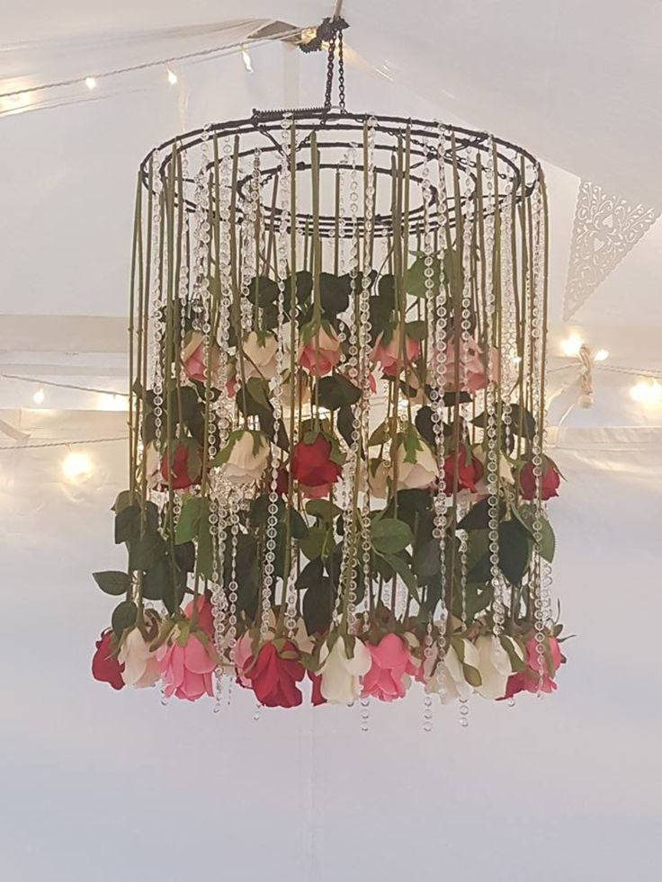 Floral chandelier to hang above the bride and groom.  The crystal beads sparkled with the seed lights threaded through