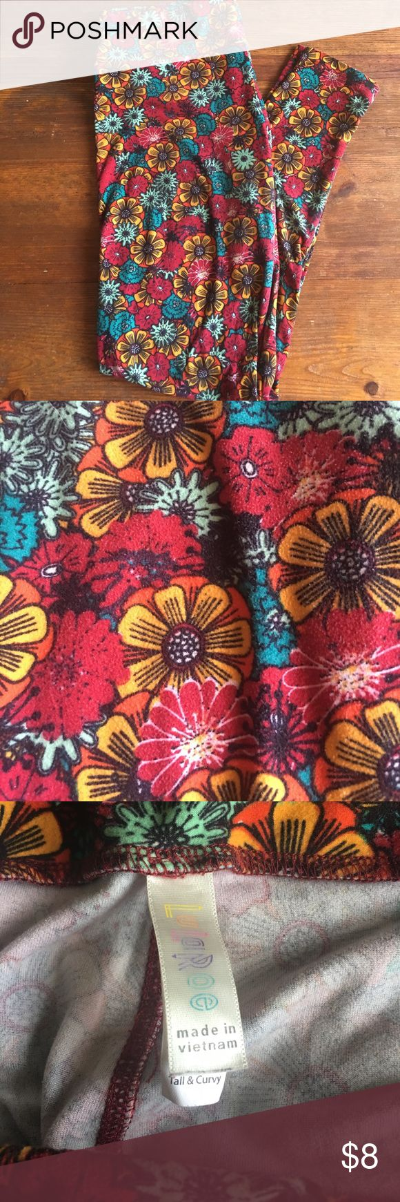 Lularoe TC leggings floral Red leggings with flowers. Some fading, and piling. Cute print. Tall and curvy size. Lularoe. Comes from clean smoke free home LuLaRoe Pants Leggings