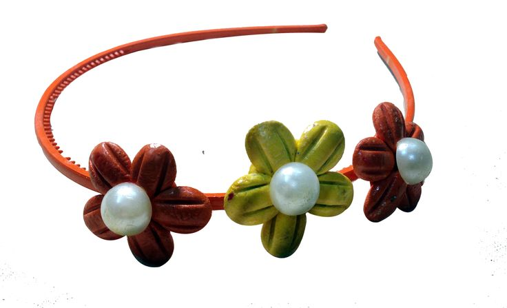 Orange-Yellow color flower Hair-band (three flowers), made of  mineral clay with a pearl on each, designed and crafted by village   women, giving a new fashion style to hair accessories.   Color: Orange and Yellow   Material: Imported Rubber sheets   Base material: Imported plastic Hair-band
