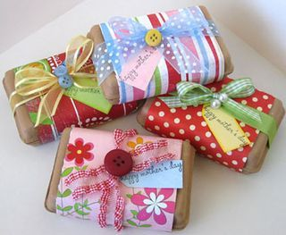 Brown paper wrapping covered with a strip of pretty scrapbook paper and ribbon.