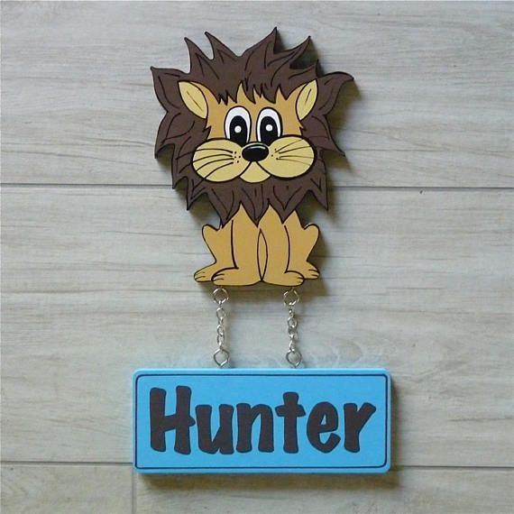 Kids lion door sign. Kids wooden name signs look fantastic displayed on your childs bedroom door play rooms. Custom kids name signs make a wonderful new baby gift. Each door plaque is personalised and hand painted just for you. Door signs are varnished for added protection. This also allows the plaque to be easily wiped cleaned with a damp cloth.  This listing is for a Kids Lion Door Sign /Plaque.  Motif is made of 9 mm MDF and is 15 mm high or wide depending on the shape.  Name plaques ...