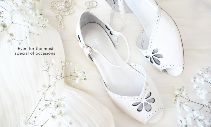 Snow white leather vintage flats by Charlie Stone shoes, perfect for everyday wear to even the most special occasions.
