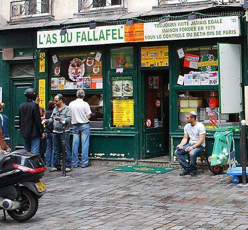 L'as du Falafel has the most famous cheap meal in Paris. Their falafel is outstanding and it's best eaten on a bench in the nearby Place des Vosges.