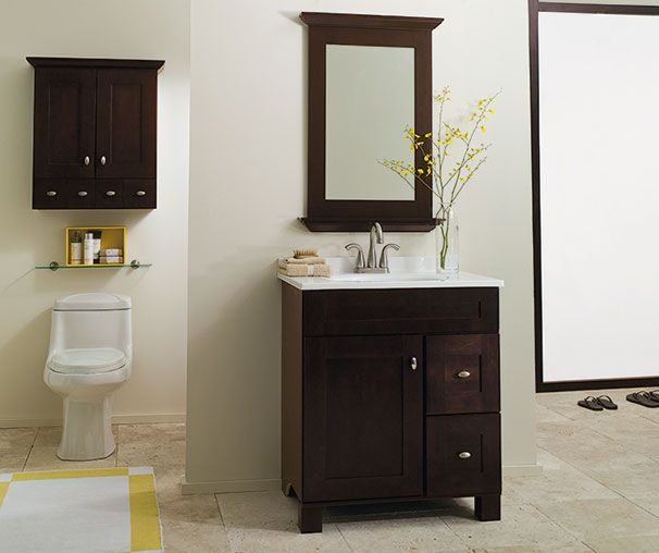 a deep cherry stain substantial yet simple door rails and flat center panel make palencia a choice for the bath a matching wall cabinet
