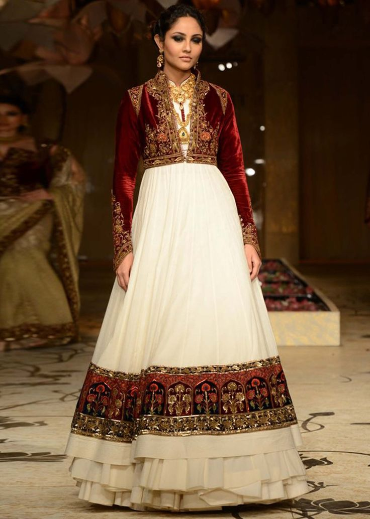 Model showcasing a cream outfit with maroon embellished jacket for Rohit Bal at Indian Bridal Week 2013
