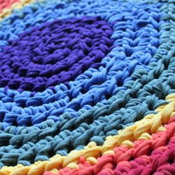 Rainbow Rug From T-Shirts!  Beautiful, useful, thrifty, AND good for the planet- turn cast-off t-shirts into a colorful throw rug.