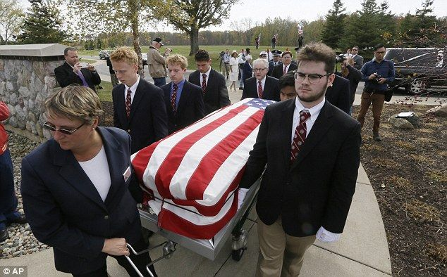 Students at a Detroit high school have volunteered to carry the coffins of homeless military veterans so they can become 'men for others'.   The scheme was launched at the University of Detroit Jesuit High School to allow students to give something back to society.   More than 50 of the youngsters have signed up to be pallbearers from the all-boy Catholic prep school.