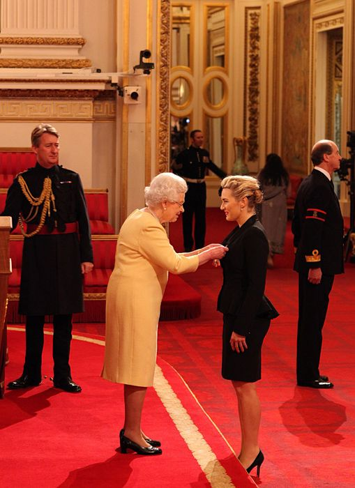 British actress Kate Winslet being made a Commander of the Order of the British Empire (CBE) for services to drama by Queen Elizabeth II at Buckingham Palace on 21 Nov 2012