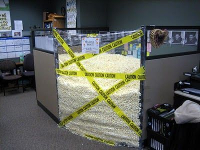 Foam peanuts fill entire cubicle, held inside by plastic wrap! Wouldn't want to come back to this cubicle! #foampeanuts #plasticwrap #workpranks