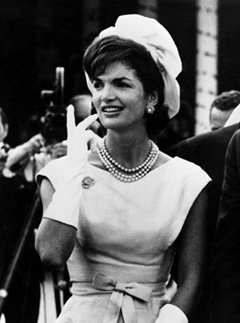Jacqueline Kennedy. Perfection in a pillowbox hat, white gloves, and three-strand pearls. Oh, Jackie-O!