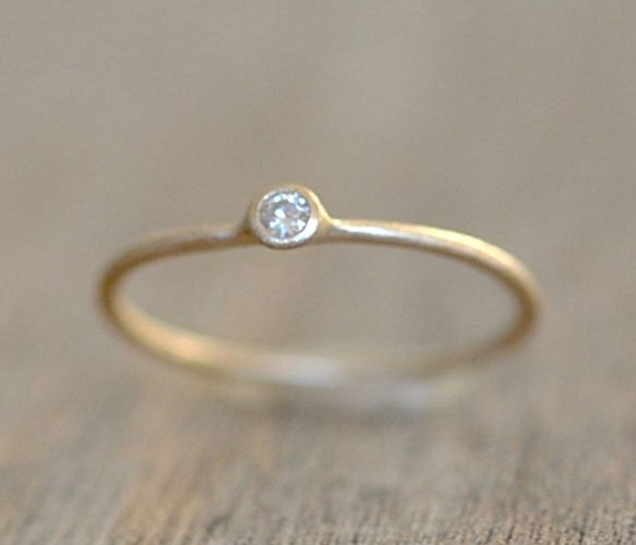 gold moissanite ring.