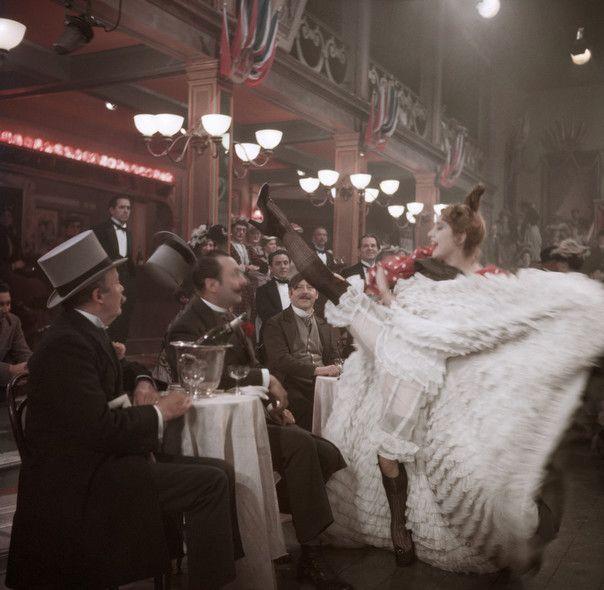 "On the set of ""Moulin Rouge,"" Paris, 1952. (Robert Capa/International Center of Photography/Magnum Photos)"