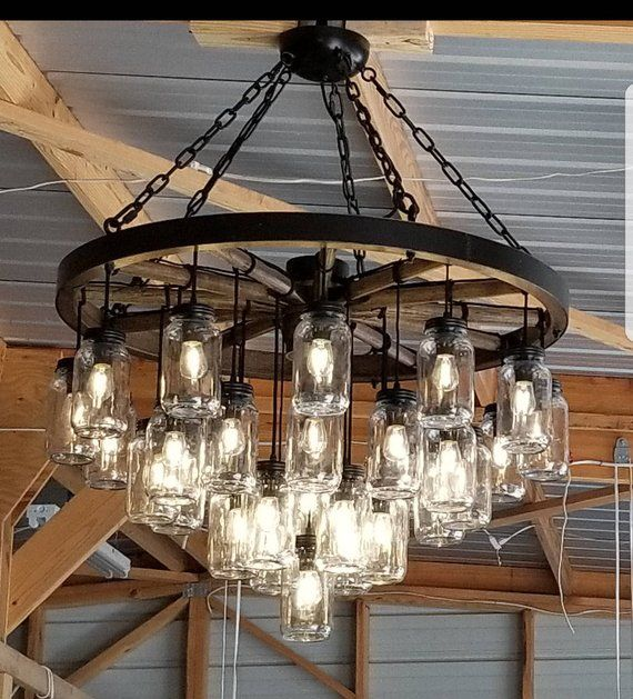 A Wagon Wheel Chandelier With A Mix Of Rustic Vintage Features Etsy Wagon Wheel Chandelier Wagon Wheel Chandelier