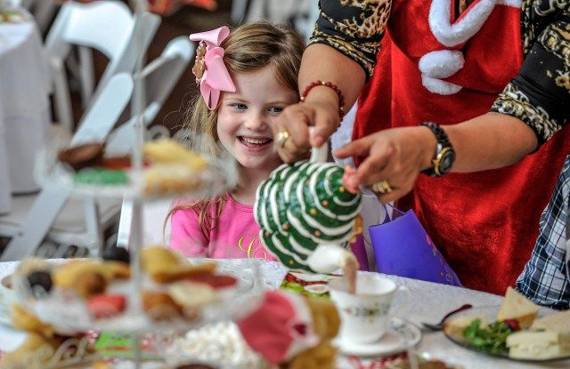 We don't know what's sweeter–all those perfectly smocked, teddy bear toting tea goers or the petit four laden dessert trays rolling through Atlanta's favorite holiday tea times. And don't tell anyone, but many of the following tea times are visited by Santa himself! So if you missed the registration deadlines in October to see the Big Guy, you're not out of the game yet. Read on for the scoop on...