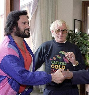 """Saville with Sutcliffe, the Yorkshire Ripper. """"Jimmy Saville, the Grey, Shadowy Figure in the Background""""."""