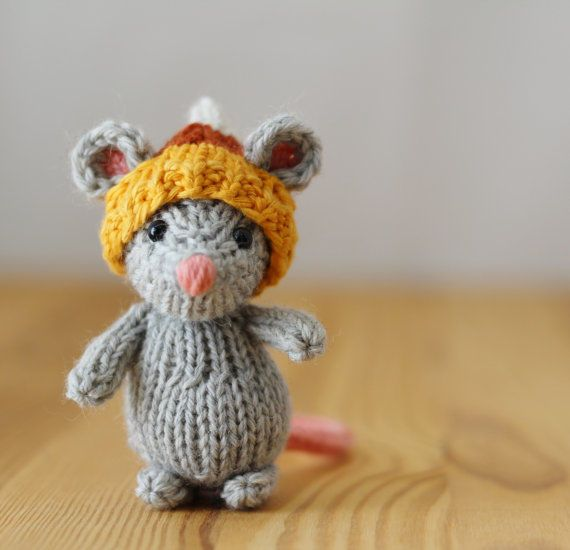Yarnigans: Little knitted candy corn mouse. This little mouse is a handmade Yarnigans original.  The product of years worth of redesigns and product testing, it's an heirloom toy sure to become a fast friend.   It's the perfect size to be carried along in a pocket for playtime to go. American made in Salisbury, MD.