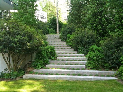 piet blanckaert, landscape architect Concrete stairs broaden at the base to open up the flow to the lawn area