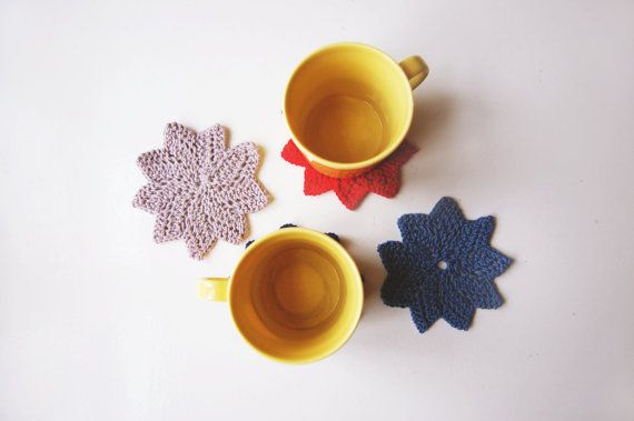 Knitted star coasters by FindingNorth on Etsy