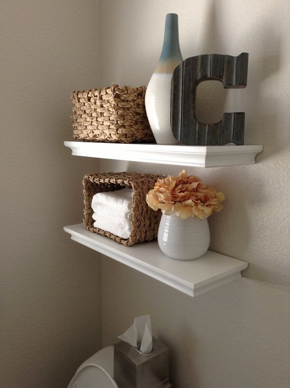 Shelves for small bathroom -hide toilet paper rolls in small decorative basket on the highest shelf so it's out of sight: