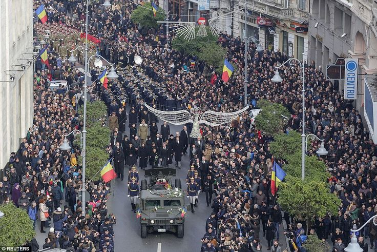 Soldiers carry the coffin of late Romanian King Michael during a funeral ceremony in Bucha...