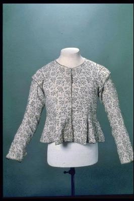 Jacket    Woman's close-fitting long sleeved jacket, with centre-front fastening and a round neck, embroidered with fine black wool in a pattern of barberries