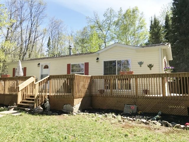 346.17A–Affordable Cottage Whitestone Lake | HomeLife – Al Boucher Real Estate Ltd. Brokerage - This 1 bedroom modular building is perfect for a home or cottage. Turn key building is well maintained, comes furnished and has a deck along the front. Dock at shoreline and hydro is underground providing unhindered usage of the lot. Whitestone Lake is spring fed and great for fishing!!! 346.17A $199,900