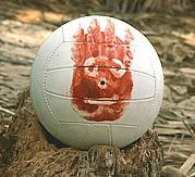 "One of the original volleyball props was sold at auction after release of the film Cast Away for 18,500 dollars to the ex-CEO of FedEx Office, Ken May. At the time of the film's release, Wilson Sporting Goods launched its own joint promotion centered around the fact that one of its products was ""co-starring"" with Tom Hanks. Wilson manufactured a volleyball with a reproduction of the bloodied handprint face on one side."