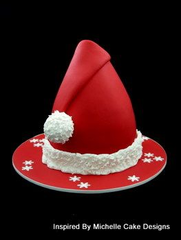 christmas-fondant-cakes-santa-hat....If I make one, the board needs to be another color, looks too much like a witches hat.
