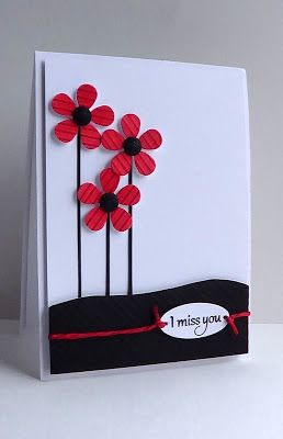 handmade card ... black and white with splashes of red ... sweet red flowers on a mostly red card ...