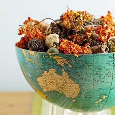 DIY New twist on bowls...cut a globe in half!  OR better yet, cover a bowl!