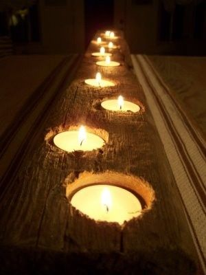 Drill holes in wood and place tea lights inside. Makes a simply, beautiful outdoor table center piece.