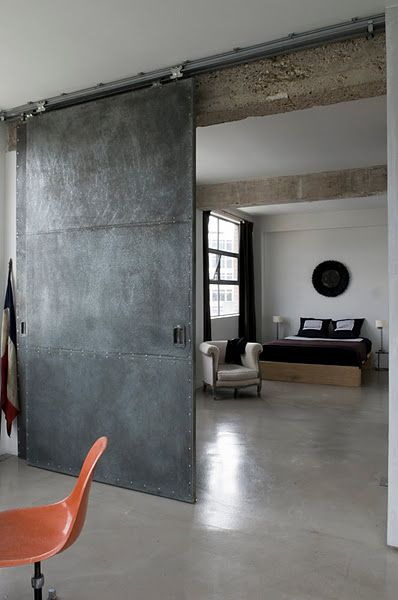 Industrial sliding door... I would love this if I lived in a city in a loft-style apartment!