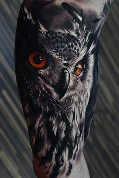 Realistic Owl Tattoo with Orange eyes.