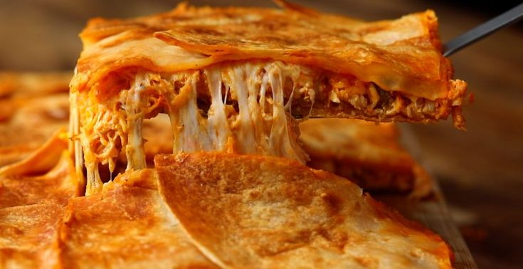 Quesadillas - the grilled cheese of the tortilla world. Our Sheetpan Buffalo Chicken Quesadillas will have you craftily making a massive one and filling it with everyone's favourite thing, buffalo chicken, along with delicious mozzarella. The perfect thing to make for a few friends on game day.