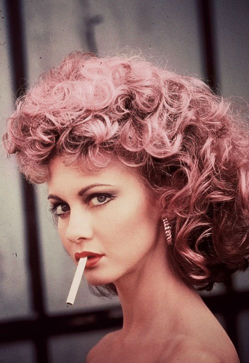 Olivia newton jones with pink hair in Grease