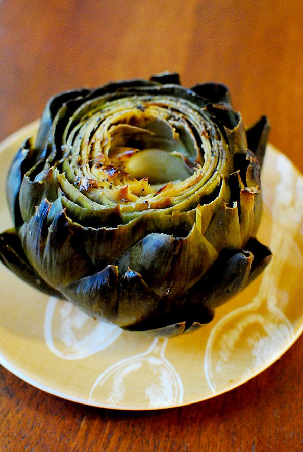 Roasted Artichokes with Lemon & Garlic- This is such a great way to prepare artichokes.. I've always boiled mine, but after trying these baked I will never boil again!
