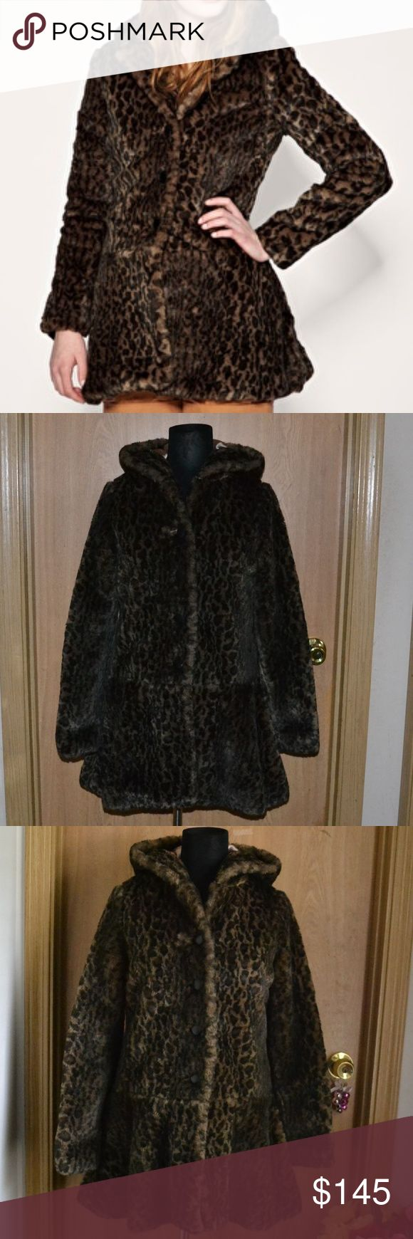 Free People faux leopard fur coat size small Smoke free home! Bundle & save! I ship Monday- Friday~  sold out online!  A gorgeous, super soft faux leopard print jacket with dropped waist size S/P in excellent condition. There are no flaws. Looks luxurious & absolutely beautiful!    Materials: 30% modacrylic 20% polyester  body lining: 95% cotton  5% spandex sleeve lining: 100% aceta Dry clean only. Free people Jackets & Coats