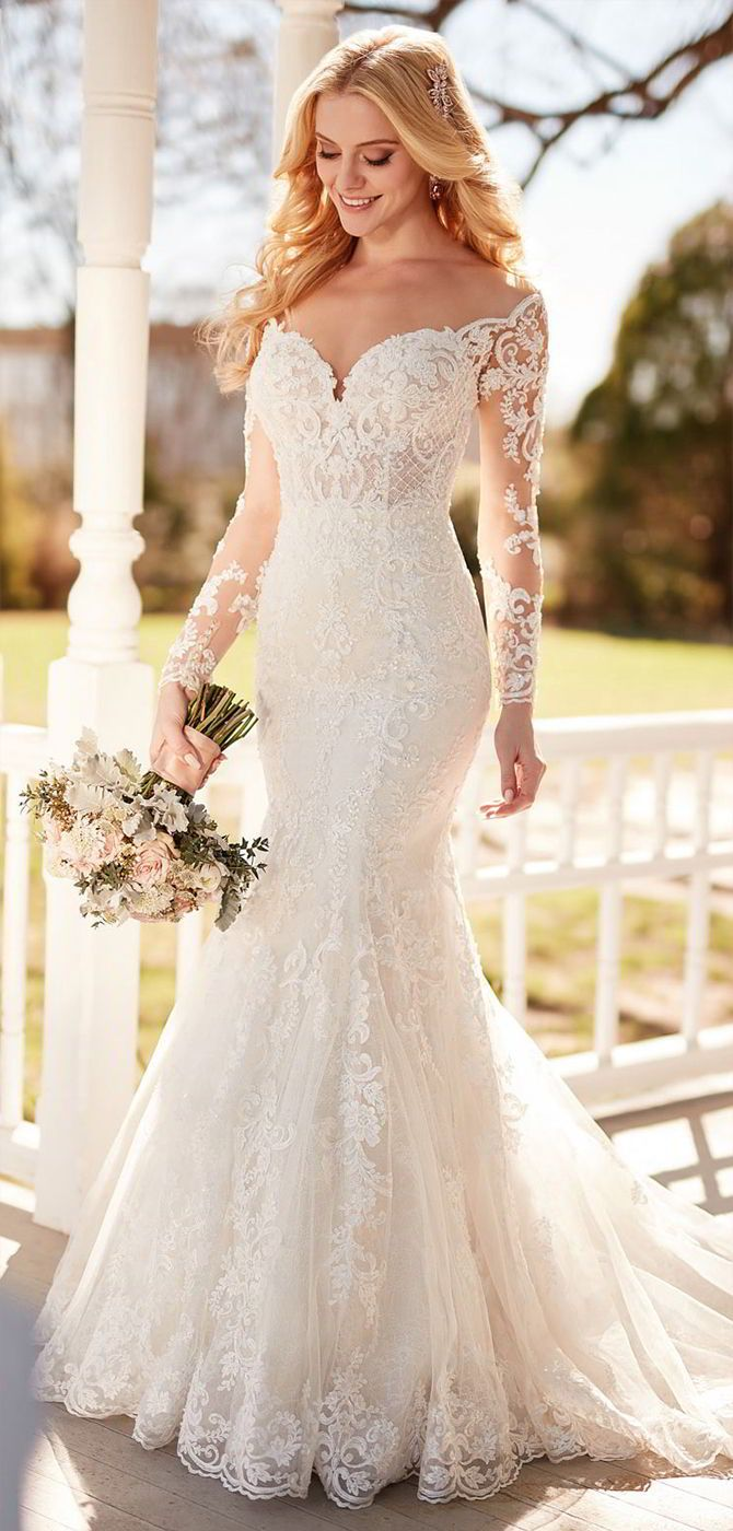 A unique mix of fabrics and textures begin your forever in style and romance with this wedding dress with sleeves from Martina Liana. Long, illusion-lace sleeves add a vintage-inspired element to this gown and perfectly offset the wide, off-the-shoulder neckline. Embroidered French lace and unique lattice work pair to create a true juxtaposition in this style, mixing soft elements with architectural-inspired detailing. Including a mix of pearl and bugle beads, the romantic pattern of this…