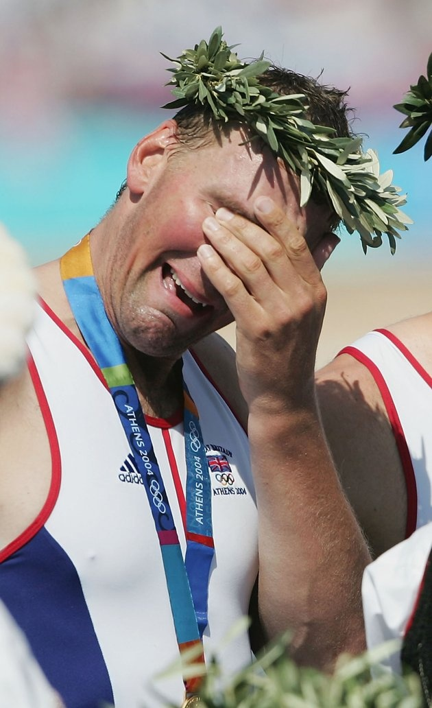 Inspirational Moments: Olympic celebrations - A tearful Matthew Pinsent of Great Britain stands on the podium during the medal ceremony for the men's four event on August 21, 2004 during the Athens 2004 Summer Olympic Games at the Schinias Olympic Rowing and Canoeing Centre in Athens, Greece. (Photo by Shaun Botterill/Getty Images)