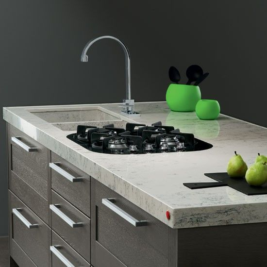 Okite  As well as being resistant to stains and scratches, Okite has a natural stone appearance. This Venati worktop is given character by its veined marble effect.