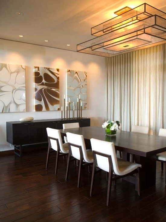 The chairs are from HOLLY HUNT, and the custom light fixture is by Pagani  Studio · Contemporary Dining Room