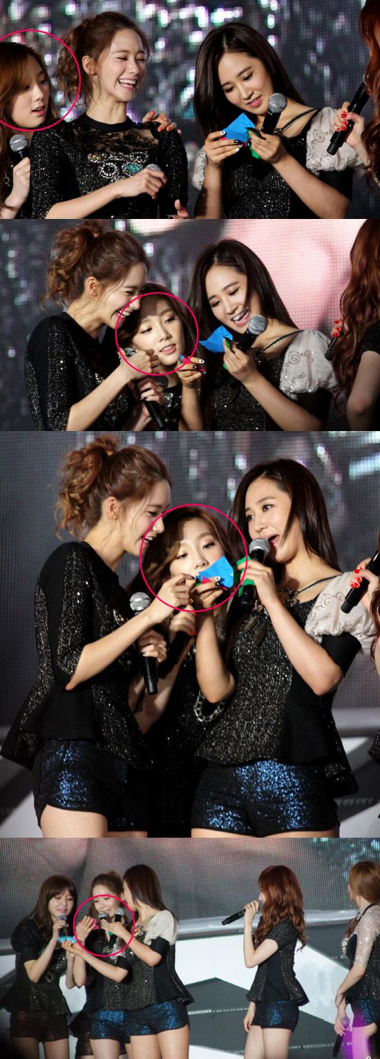 Photos of Taeyeon trying to read a letter next to tall Girls' Generation members draw laughter